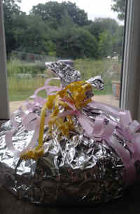 Cake wrapped in tin foil with bows
